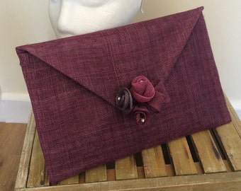 Purple and berry clutch bag