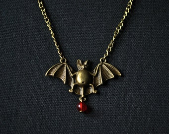 Bronze bat necklace with Pearl