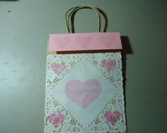 Gift bag one of a kind. Removable topper and gift tag. Valentines. Pink and white 2.00 discount if purchasing set of 5