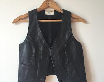 little black leather vest