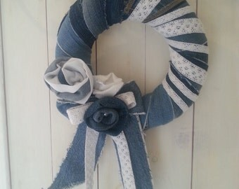 Decoration - or wreath from jeans with white lace