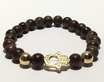 WIRED Turtoise Shell and Gold Beaded Hamsa Bracelet
