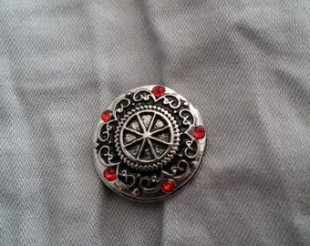 Click button with red rhinestones