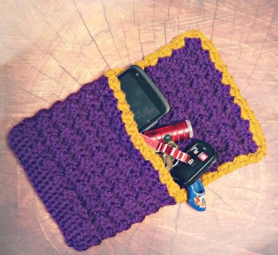 Small crochet envelope clutch in purple and gold