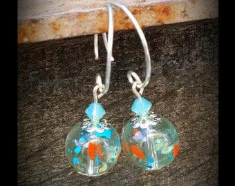 Glass specked bead earrings with a blue Swarovski crystal bead