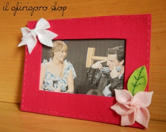 Frame for photos of felt, with decorations.