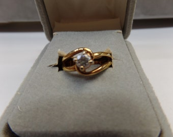 ring, cz, gold tone size 4.75 used