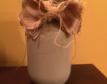 Chalk painted mason jar with a burlap bow