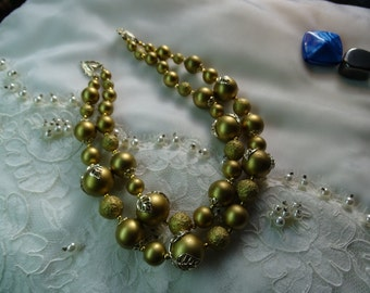 Golden bead double strand necklace.