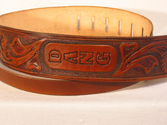 Hand carved sheridan style leather guitar strap