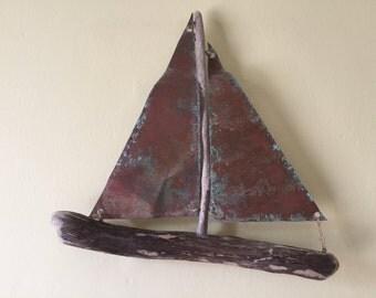 Driftwood sailing boat