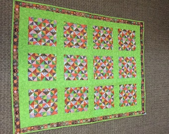 Lime green lap quilt, a mix of vintage and modern day fabric