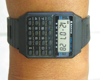 Vintage Sanyo Digital wrist watches, world time+ calculator feature
