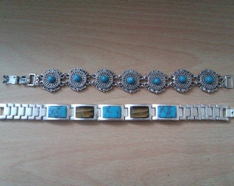 2 silver coloured bracelets