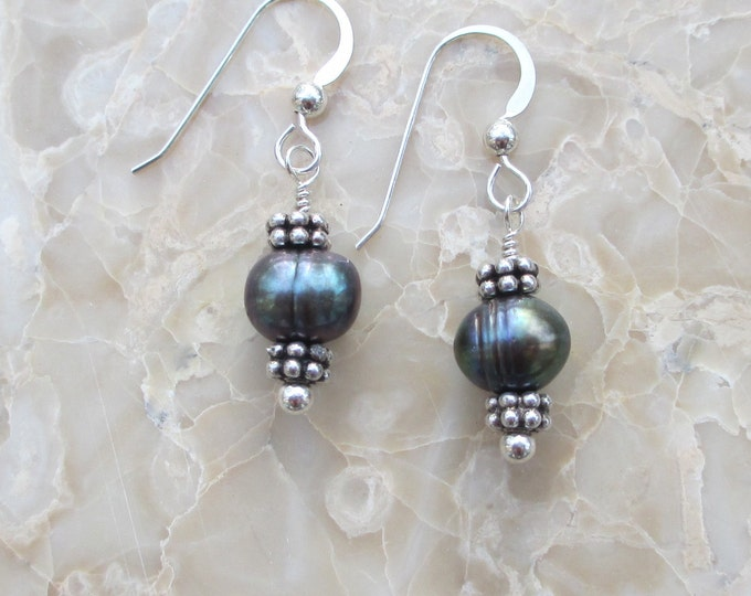 handmade black freshwater pear earrings with sterling silver spacer beads on sterling silver ear wires