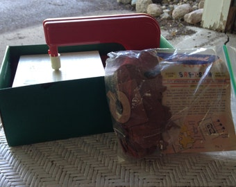 Vintage toy saw machine with all pieces and original box made is usa