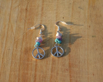 Crystal earrings with a charm