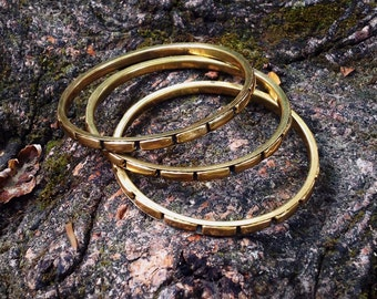 "Three brass bracelets ""Bangle"""