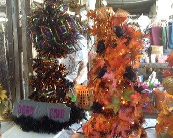 Fall and Halloween trees with lights and wreaths