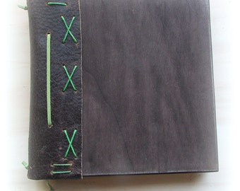 Book of wood bound in leather with bookmarks
