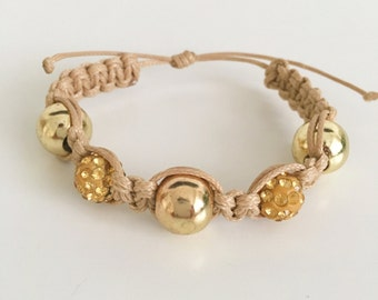 Beige Woven Bracelet with Gold Fire Ball