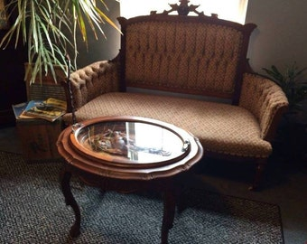 victorian Eastlake style couch and Vintage table