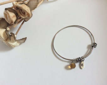 Silver bracelet with yellow bead and crown charm