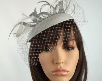 Pale Silver fascinator hat Grey Fascinator Wedding Hatinator Pillbox Hat and net veil. Races, Weddings, Bride, Occasion, Parties,