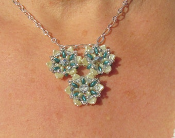 Floral snowflake pendant on delicate silver chain
