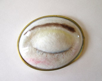 Felted eye of the moon in a frame