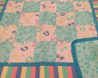 blue and pink feet and hands quilt