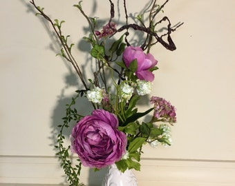 Silk flower arrangement in ivory ceramic vase