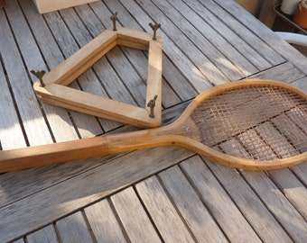 old tennis racket in wood with frame, rope hose from 1920