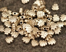 20 metal beads 7 mm x 3 mm antique silver leaf