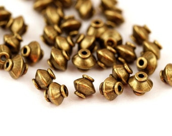 20 metal beads 7 x 7.5 mm bronze