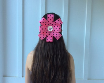 Festive pink polka dotted bow