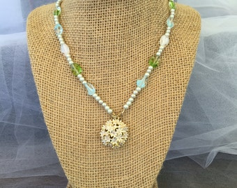 Green/blue beaded necklace with flower pendant