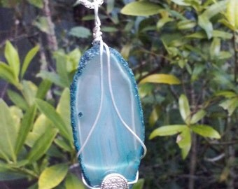 Blue Agate wrapped in silver plated wire with a silver plated bead
