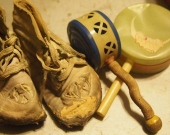 vintage 1940's baby shoes and toys