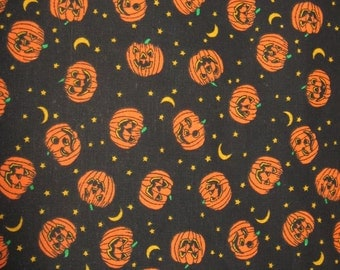 Fabric.  Halloween Jack-o-Lantern Fabric with black background