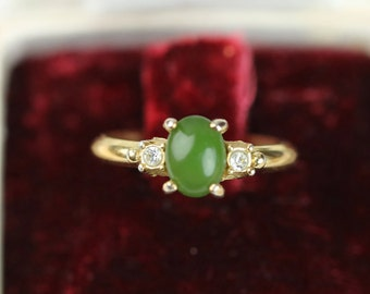 Old gold color gold ring from the 70's set with a Russian jade and 2 cubic zirconium