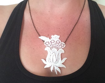 Beautiful white vintage lace pendant on a bronze chain