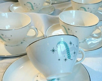 Blue Heaven Tea Service for 10. Vintage Canonsburg Pottery, 1950s. With blue feather, atomic starbursts, and titanium trim.