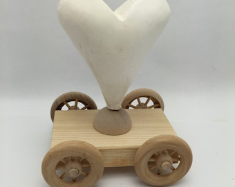 "plaster heart on wood wheel base ready to decorate size is 5 1/2 "" x 4 1/4 "" x 3"""