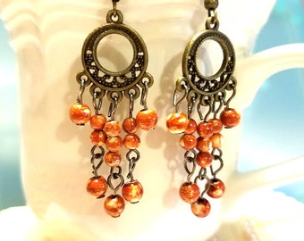 Glamour, bohemian, vibrant orange earrings