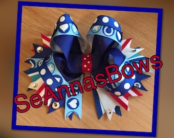 Red white and blue boutique bow with spikes
