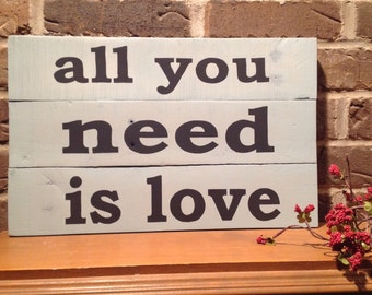 all you need is love. Repurposed, hand painted pallet sign