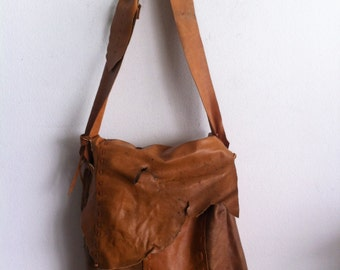 Orange large shoulder bag on a long strap, a bag made of genuine leather.