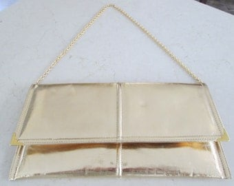 Gold Clutch Purse with Chain Handle.