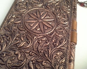 Keep notes.....metal covered journal